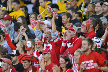 IOWA CITY, IA - OCTOBER 23: Wisconsin fans celebrate their team win over the University of Iowa Hawkeyes at Kinnick Stadium on October 23, 2010 in Iowa City, Iowa. Wisconsin won 31-30 over Iowa. (Photo by David Purdy/Getty Images).