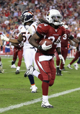 GLENDALE, AZ - DECEMBER 12:  Runningback Tim Hightower #34 of the Arizona Cardinals scores a 8 yard rushing touchdown against the Denver Broncos during the fourth quarter of the NFL game at the University of Phoenix Stadium on December 12, 2010 in Glendal