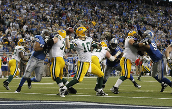 DETROIT - DECEMBER 12:  Matt Flynn #10 of the Green Bay Packers drops back to pass during the third quarter of the game against the Detroit Lions at Ford Field on December 12, 2010 in Detroit, Michigan. The Lions defeated the Packers 7-3.  (Photo by Leon