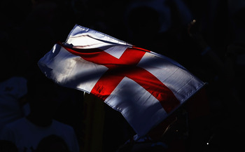 DUBAI, UNITED ARAB EMIRATES - DECEMBER 03: A member of the crowd flies an England flag on day two of the Dubai Rugby Sevens, the opening tournament of the HSBC Sevens World Series at 7he Sevens ground on December 3, 2010 in Dubai, United Arab Emirates.  (