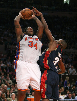 NEW YORK - MARCH 05:  Eddy Curry #34 of the New York Knicks shoots against Joe Smith #32 of the Cleveland Cavaliers during their game on March 5, 2008 at Madison Square Garden in New York City.   NOTE TO USER: User expressly acknowledges and agrees that,