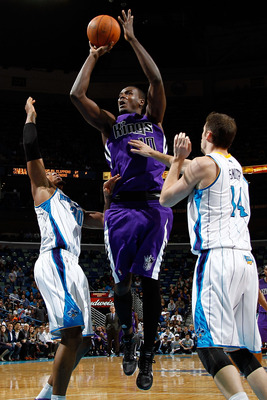 NEW ORLEANS, LA - DECEMBER 15:  Samuel Dalembert #10 of the Sacramento Kings shoots the ball over David West #30 and Jason Smith #14 of the New Orleans Hornets  at the New Orleans Arena on December 15, 2010 in New Orleans, Louisiana.  The Hornets defeated