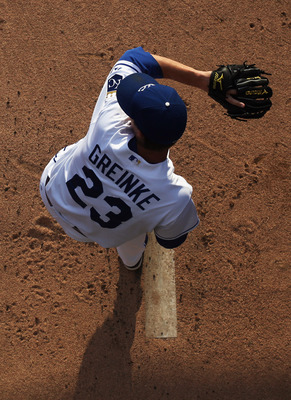KANSAS CITY, MO - JULY 26:  Starting pitcher Zack Greinke #23 of the Kansas City Royals warms-up prior to the start of the game against the Minnesota Twins on July 26, 2010 at Kauffman Stadium in Kansas City, Missouri.  (Photo by Jamie Squire/Getty Images