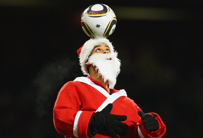 LONDON, ENGLAND - DECEMBER 20:  A ball juggler dressed as Father Christmas displays his skills at half time during the Barclays Premier League match between West Ham United and Chelsea at Upton Park on December 20, 2009 in London, England.  (Photo by Phil