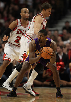 CHICAGO, IL - DECEMBER 10: Ron Artest #15 of the Los Angeles Lakers looks to pass as Kyle Korver #26 and Taj Gibson #22 of the Chicago Bulls defend at the United Center on December 10, 2010 in Chicago, Illinois. The Bulls defeated the Lakers 88-84. NOTE T