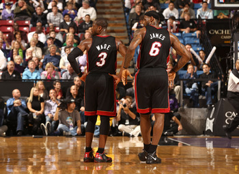 SACRAMENTO, CA - DECEMBER 11: Dwyane Wade #3 and LeBron James #6 of the Miami Heat stand on to the court during the shooting of a technical foul during their game against the Sacramento Kings at ARCO Arena on December 11, 2010 in Sacramento, California. N
