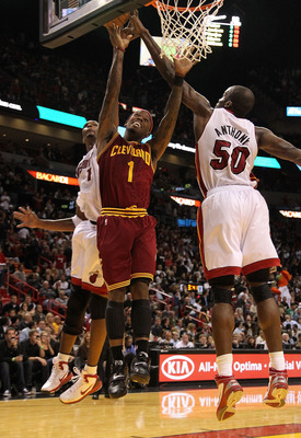 MIAMI, FL - DECEMBER 15:  Daniel Gibson #1 of the Cleveland Cavaliers is fouled by  Joel Anthony #50 of the Miami Heat during a game at American Airlines Arena on December 15, 2010 in Miami, Florida. NOTE TO USER: User expressly acknowledges and agrees th