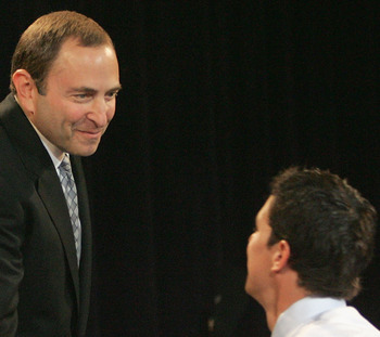 OTTAWA, ONT - JULY 30:  (L-R) Commissioner Gary Bettman of the National Hockey League greets first overall draft pick Sidney Crosby after being selected during the 2005 National Hockey League Draft on July 30, 2005 at the Westin Hotel in Ottawa, Canada.
