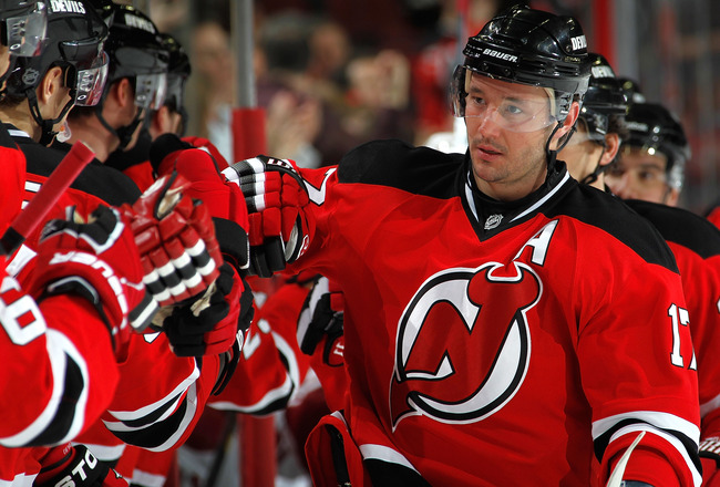 NEWARK, NJ - DECEMBER 15:  Ilya Kovalchuk #17 of the New Jersey Devils is congratulated at the Devils bench for his goal during the third period of a hockey game against the Phoenix Coyotes at the Prudential Center on December 15, 2010 in Newark, New Jers
