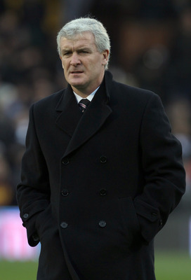 LONDON, ENGLAND - NOVEMBER 27:  Fulham manager Mark Hughes looks on at during the Barclays Premier League match between Fulham and Birmingham City at Craven Cottage on November 27, 2010 in London, England.  (Photo by Ian Walton/Getty Images)