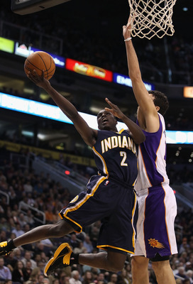 PHOENIX - DECEMBER 03:  Darren Collison #2 of the Indiana Pacers lays up a shot against Hedo Turkoglu #19 of the Phoenix Suns during the NBA game at US Airways Center on December 3, 2010 in Phoenix, Arizona. NOTE TO USER: User expressly acknowledges and a
