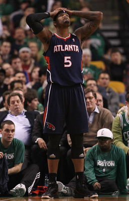 BOSTON, MA - DECEMBER 16:  Josh Smith #5 of the Atlanta Hawks reacts after a foul is called against him in the second half against the Boston Celtics on December 16, 2010 at the TD Garden in Boston, Massachusetts. The Celtics defeated the Hawks 102-90. NO