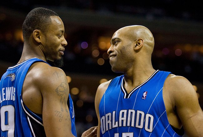 CHARLOTTE, NC - APRIL 26: Rashard Lewis #9 and Vince Carter #15 of the Orlando Magic chat during a stoppage in play against the Charlotte Bobcats at Time Warner Cable Arena on April 26, 2010 in Charlotte, North Carolina.  The Magic defeated the Bobcats 99
