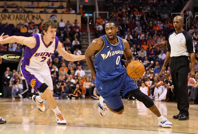 PHOENIX - DECEMBER 19:  Gilbert Arenas #0 of the Washington Wizards drives the ball past Goran Dragic #2 of the Phoenix Suns during the NBA game at US Airways Center on December 19, 2009 in Phoenix, Arizona. The Suns defeated the Wizards 121-95.  NOTE TO