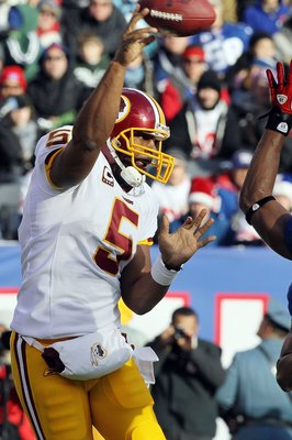 EAST RUTHERFORD, NJ - DECEMBER 05:  Donovan McNabb #5 of the Washington Redskins throws a pass against the New York Giants on December 5, 2010 at the New Meadowlands Stadium in East Rutherford, New Jersey. The Giants defeated the Redskins 31-7.  (Photo by