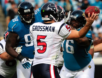 JACKSONVILLE, FL - DECEMBER 06:  Terrance Knighton #96 of the Jacksonville Jaguars pressures Rex Grossman #5 of the Houston Texans during the game at Jacksonville Municipal Stadium on December 6, 2009 in Jacksonville, Florida.  (Photo by Sam Greenwood/Get