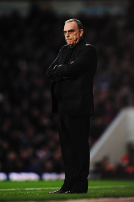 LONDON, UNITED KINGDOM - DECEMBER 11:  Avram Grant the West Ham United manager watches from the touchline during the Barclays Premier League match between West Ham United and Manchester City at Upton Park on December 11, 2010 in London, England.  (Photo b