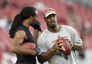 GLENDALE, AZ - SEPTEMBER 02:  Quarterback Donovan McNabb #5 of the Washington Redskins talks with Larry Fitzgerald #11 of the Arizona Cardinals before the preseason NFL game at the University of Phoenix Stadium on September 2, 2010 in Glendale, Arizona. T