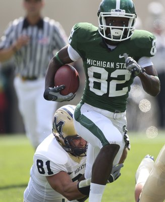 EAST LANSING, MI - SEPTEMBER 05: Wide receiver Keshawn Martin #82 of the Michigan State Spartans runs for a first down in the second quarter as Kyle Begger #81 of Montana State attempts to make the stop on September 5, 2009 at Spartan Stadium in East Lans