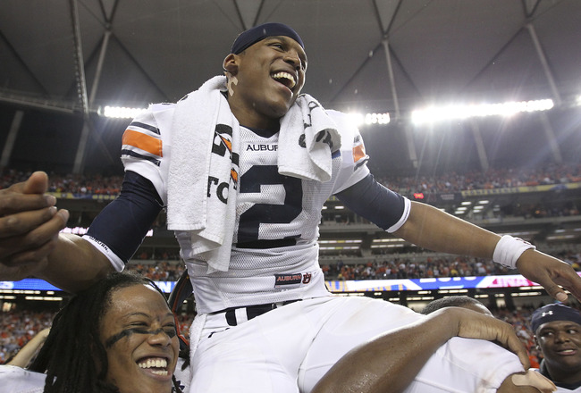 ATLANTA - DECEMBER 4:  Quarterback Cam Newton #2 of the Auburn Tigers is carried on the field after the 2010 SEC Championship against the South Carolina Gamecocks at Georgia Dome on December 4, 2010 in Atlanta, Georgia. (Photo by Mike Zarrilli/Getty Image