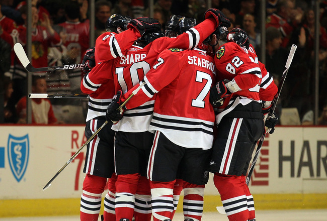 CHICAGO, IL - DECEMBER 17: Patrick Sharp #10 of the Chicago Blackhawks celebrates a 1st period goal  with teammates including Brent Seabrook #7 and Tomas Kopecky #82 against the Detroit Red Wings at the United Center on December 17, 2010 in Chicago, Illin