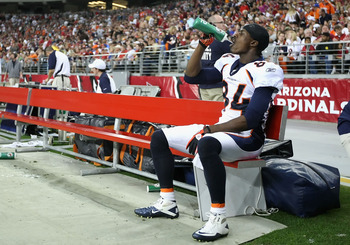 GLENDALE, AZ - DECEMBER 12:  Wide receiver Brandon Lloyd #84 of the Denver Broncos drinks water on the bench during the NFL game against the Arizona Cardinals at the University of Phoenix Stadium on December 12, 2010 in Glendale, Arizona.  The Cardinals d
