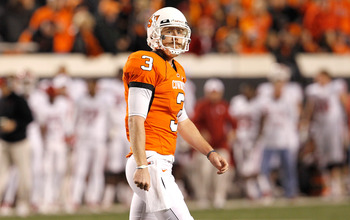 STILLWATER, OK - NOVEMBER 27:  Quarterback Brandon Weeden #3 of the Oklahoma State Cowboys walks off the field after failing to make a first down against the Oklahoma Sooners at Boone Pickens Stadium on November 27, 2010 in Stillwater, Oklahoma.  (Photo b
