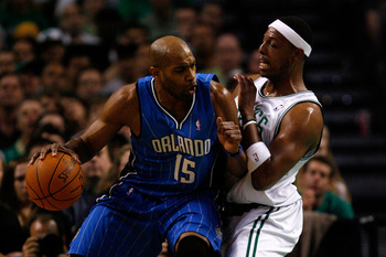 BOSTON - MAY 24:  Vince Carter #15 of the Orlando Magic dribbles against Paul Pierce #34 of the Boston Celtics in Game Four of the Eastern Conference Finals during the 2010 NBA Playoffs at TD Banknorth Garden on May 24, 2010 in Boston, Massachusetts.  NOT