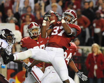 TUSCALOOSA, AL - NOVEMBER 13: Defensive back Robert Lester #37 of the Alabama Crimson Tide intercepts a pass against the Mississippi State Bulldogs November 13, 2010 at Bryant-Denny Stadium in Tuscaloosa, Alabama.  (Photo by Al Messerschmidt/Getty Images)
