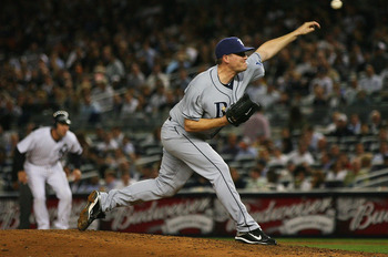 NEW YORK - SEPTEMBER 21:  Jake McGee #57 of the Tampa Bay Rays pitches against the New York Yankees on September 21, 2010 at Yankee Stadium in the Bronx borough of New York City. The Yankees defeated the Rays 8 - 3. (Photo by Andrew Burton/Getty Images)