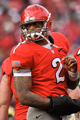 COLUMBUS, OH - NOVEMBER 27:  Quarterback Terrelle Pryor #2 of the Ohio State Buckeyes gets ready to call the play in the huddle against the Michigan Wolverines at Ohio Stadium on November 27, 2010 in Columbus, Ohio.  (Photo by Jamie Sabau/Getty Images)