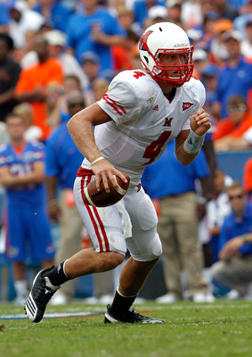 GAINESVILLE, FL - SEPTEMBER 04:  Quarterback Zac Dysert #4 of the Miami University RedHawks runs against the Florida Gators at Ben Hill Griffin Stadium on September 4, 2010 in Gainesville, Florida.  (Photo by Sam Greenwood/Getty Images)