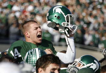 EAST LANSING, MI - NOVEMBER 01:  Brett Swenson #14 of the Michigan State Spartans reacts on his teammates shoulders after kicking game winning field goal to beat the Wisconsin Badgers 25-24 on November 1, 2008 at Spartan Stadium in East Lansing, Michigan.