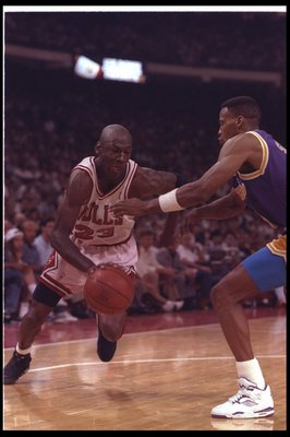 2 May 1991: Guard Michael Jordan of the Chicago Bulls (left) moves against the Los Angeles Lakers during Game One of the NBA finals at the United Center in Chicago, Illinois. The Lakers won the game, 93-91.