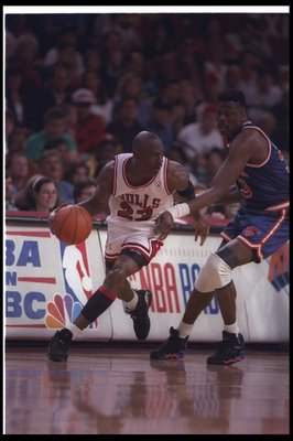 1993:  Guard Michael Jordan of the Chicago Bulls (left) works against the New York Knicks during the Eastern Conference finals at the United Center in Chicago, Illinois.  The Bulls won the game, 103-83. Mandatory Credit: Jonathan Daniel  /Allsport