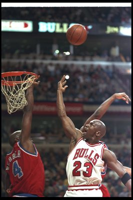 27 Apr 1997:  Michael Jordan of the Chicago Bulls tries to get the ball in as Chris Webber of the Washington Bullets knocks it out during the first round of the NBA Playoffs at United Center in Chicago, Illinois. The Bulls won 109-104.  Mandatory Credit: