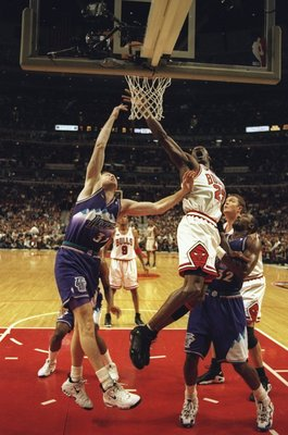 7 Jun 1998:  Michael Jordan #23 of the Chicago Bulls goes up for a shot as Adam Keefe #31 and Karl Malone #32 of the Utah Jazz try to stop him during the NBA Finals game 3 at the United Center in Chicago, Illinois.  The Bulls defeated the Jazz 96-54. Mand