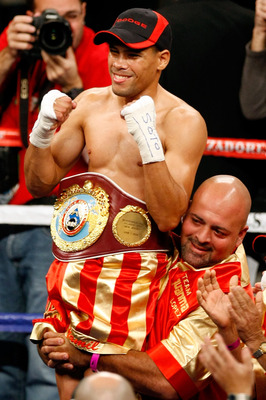 LAS VEGAS - DECEMBER 06:  (L-R) Juan Manuel Lopez of Puerto Rico celebrates after defeating Sergio Medina of Argentina during their WBO junior featherweight title fight at the MGM Grand Garden Arena December 6, 2008 in Las Vegas, Nevada.  (Photo by Ethan