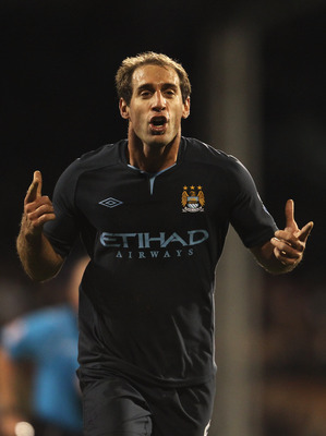 LONDON, ENGLAND - NOVEMBER 21: Pablo Zabaleta of Manchester City celebrates scoring his teams second goal during the Barclays Premier League match between Fulham and Manchester City at Craven Cottage on November 21, 2010 in London, England.  (Photo by Sco