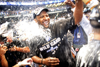 MILWAUKEE - SEPTEMBER 28:  CC Sabathia of the Milwaukee Brewers is sprayed by champaign as he and the Brewers celebrate clinching the National League Wild Card after the game against the Chicago Cubs at Miller Park on September 28, 2008 in Milwaukee, Wisc