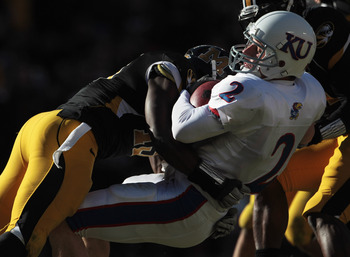 KANSAS CITY, MO - NOVEMBER 27:  Quarterback Jordan Webb #2 of the Kansas Jayhawks carries the ball into the endzone for a touchdown as Kenji Jackson #13 of the Missouri Tigers defends on November 27, 2010 at Arrowhead Stadium in Kansas City, Missouri.  (P