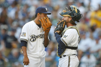 MILWAUKEE, WI - APRIL 05: Pitcher Yovani Gallardo #49 of the Milwaukee Brewers talks with catcher Gregg Zaun #9 against the Colorado Rockies at the Miller Park on April 05, 2010 in Milwaukee, Wisconsin. The Rockies defeated the Brewers 5-3.(Photo by Scott