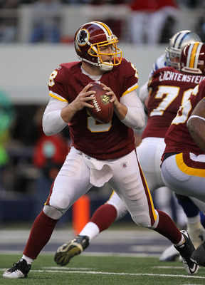 ARLINGTON, TX - DECEMBER 19:  Quarterback Rex Grossman #8 of the Washington Redskins passes against the Dallas Cowboys at Cowboys Stadium on December 19, 2010 in Arlington, Texas.  (Photo by Ronald Martinez/Getty Images)