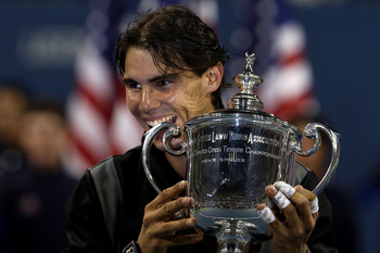 NEW YORK - SEPTEMBER 13:  Rafael Nadal of Spain bites the championship trophy during the trophy ceremony after defeating Novak Djokovic of Serbia to win the men's singles final on day fifteen of the 2010 U.S. Open at the USTA Billie Jean King National Ten