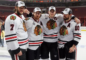 PHILADELPHIA - JUNE 09: (L-R) Brent Seabrook #7, Duncan Keith #2, Jonathan Toews #19 and Patrick Sharp #10 of the Chicago Blackhawks celebrate after the Blackhawks defeated the Philadelphia Flyers 4-3 in overtime to win the Stanley Cup in Game Six of the