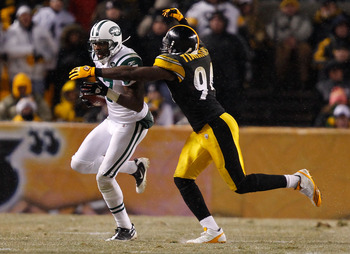 PITTSBURGH - DECEMBER 19:  Braylon Edwards #17 of the New York Jets runs after catching a pass in front of Lawrence Timmons #94 of the Pittsburgh Steelers during the game on December 19, 2010 at Heinz Field in Pittsburgh, Pennsylvania.  (Photo by Jared Wi
