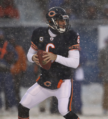 CHICAGO, IL - DECEMBER 12: Jay Cutler #6 of the Chicago Bears looks for a receiver against the New England Patriots at Soldier Field on December 12, 2010 in Chicago, Illinois. The Patriots defeated the Bears 36-7. (Photo by Jonathan Daniel/Getty Images)