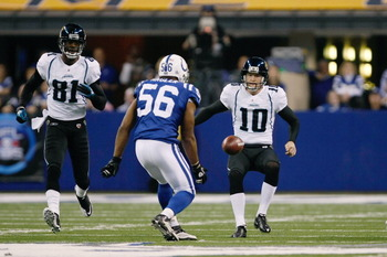 INDIANAPOLIS, IN - DECEMBER 19: Tyjuan Hagler #56 of the Indianapolis Colts runs to recover an onside kick as Josh Scobee #10 and Kassim Osgood #84 of the Jacksonville Jaguars also pursue the football at Lucas Oil Stadium on December 19, 2010 in Indianapo