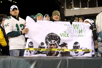 PHILADELPHIA, PA - DECEMBER 02:  Fans of the Philadelphia Eagles hold up a sigh which reads 'It's Always Sunny in Vick -adelphia in reference to quarterback Michael Vick against the Houston Texans at Lincoln Financial Field on December 2, 2010 in Philadel