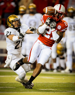 LINCOLN, NE - NOVEMBER 26: Prince Amukamara #21 of the Nebraska Cornhuskers misses a chance at an interception from Scotty McKnight #21 of the Colorado Buffaloes during the second half of their game at Memorial Stadium on November 26, 2010 in Lincoln, Neb
